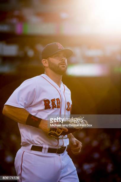 Mitch Moreland of the Boston Red Sox takes the field to warm up before a game against the Chicago White Sox on August 3 2017 in Boston Massachusetts