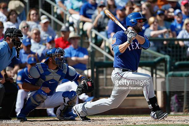 Mitch Moreland of the Texas Rangers bats against the Kansas City Royals during the cactus leauge spring training game at Surprise Stadium on March 2...