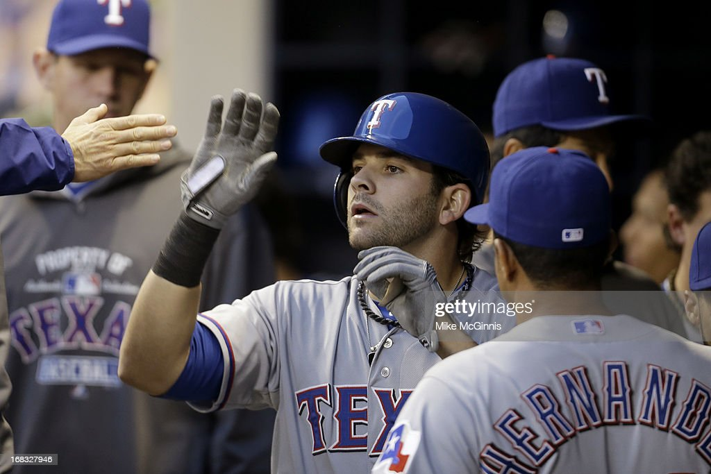 Mitch Moreland #18 of the Texas Rangers celebrates in the dugout after hitting a solo home run in the top of the third inning against the Milwaukee Brewers at Miller Park on May 08, 2013 in Milwaukee, Wisconsin.