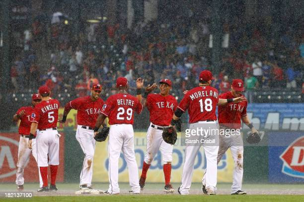 Mitch Moreland of the Texas Rangers celebrates with Adrian Beltre and Ian Kinsler after a game against the Los Angeles Angels of Anaheim at Rangers...