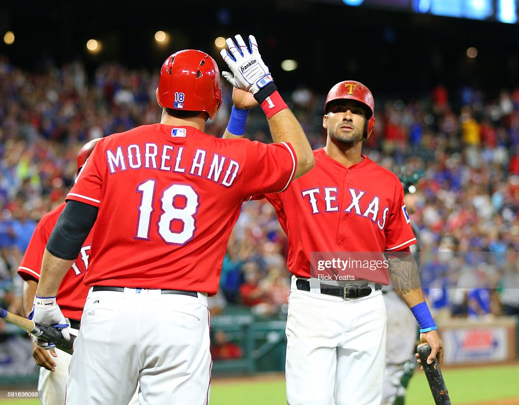 Mitch Moreland #18 of the Texas Rangers congratulates Ian Desmond #20 for scoring in the seventh inning against the Oakland Athletics at Globe Life Park in Arlington on August 17, 2016 in Arlington, Texas.
