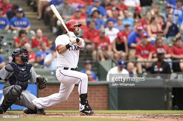 Mitch Moreland of the Texas Rangers hits a home run as he bats against the Seattle Mariners at Globe Life Park in Arlington on September 20 2015 in...