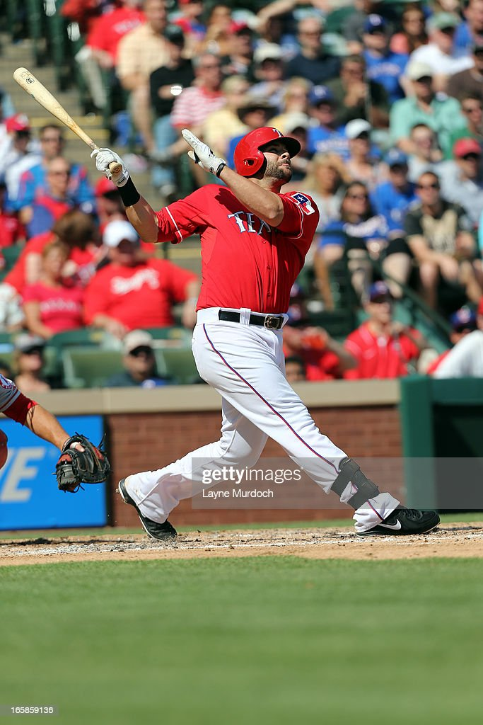 Mitch Moreland #18 of the Texas Rangers hits a home run off of Tommy Hanson #48 of the Los Angeles Angels of Anaheim in the bottom of the 3rd inning on April 6, 2013 at the Rangers Ballpark in Arlington, Texas.