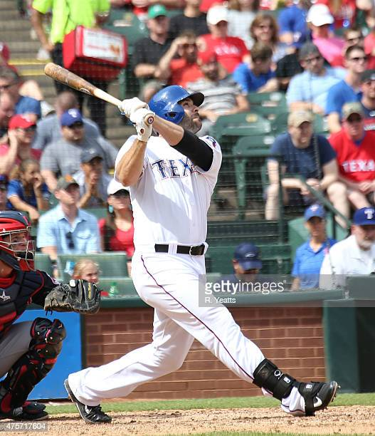 Mitch Moreland of the Texas Rangers hits a two run home run in the sixth inning against the Cleveland Indians at Globe Life Park in Arlington on May...