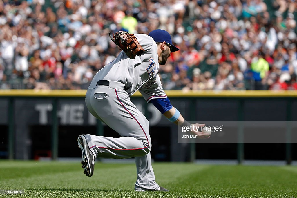 Mitch Moreland #18 of the Texas Rangers is unable to make a catch during the sixth inning against the Chicago White Sox at U.S. Cellular Field on June 21, 2015 in Chicago, Illinois. The Chicago White Sox won 3-2 in eleven innings