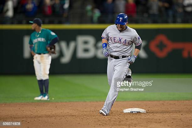Mitch Moreland of the Texas Rangers rounds the bases after hitting a solo home run off of relief pitcher Steve Cishek during the ninth inning of a...