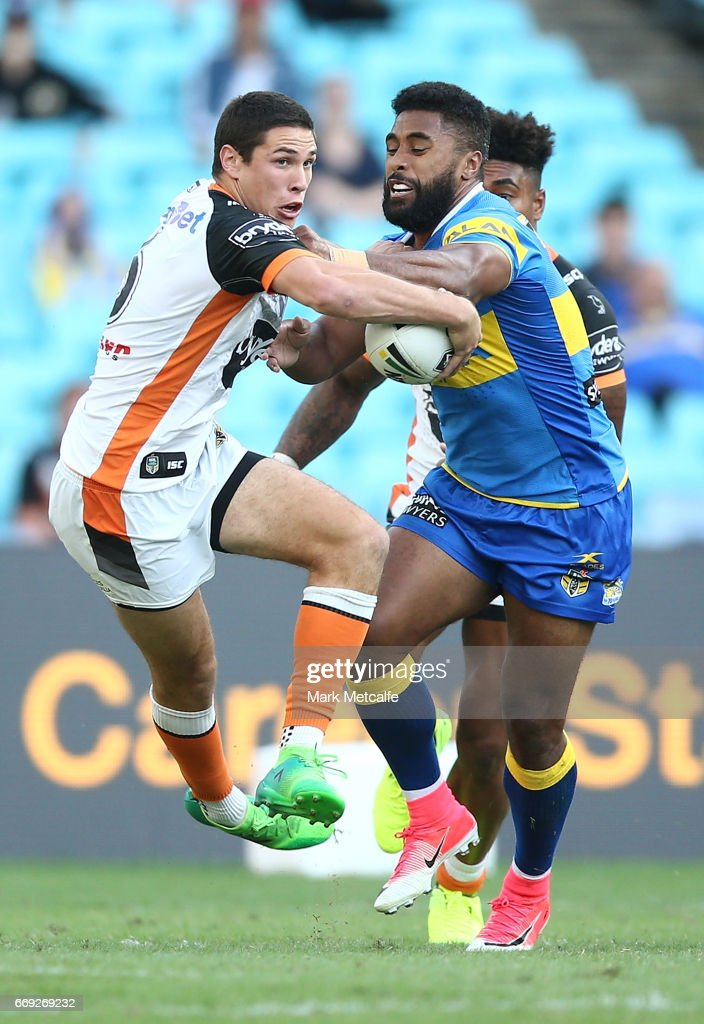 Mitch Moses of the Tigers is tackled by Michael Jennings of the Eels during the round seven NRL match between the Parramatta Eels and the Wests Tigers at ANZ Stadium on April 17, 2017 in Sydney, Australia.