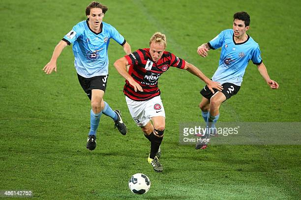 Mitch Nicholls of the Wanderers runs with the ball during the FFA Cup Round of 16 match between Palm Beach Sharks and Western Sydney Wanderers at...