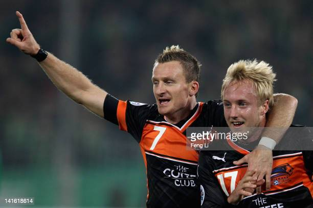 Mitch Nichols and Besart Berisha of the Roar celebrates scoring their first goal during the AFC Champions League Group F match between China's...