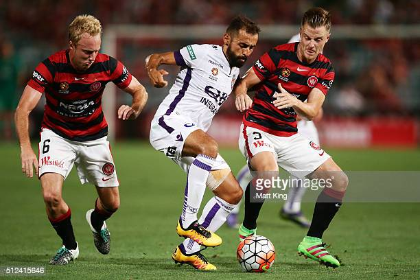 Mitch Nichols and Scott Jamieson of the Wanderers compete for the ball against Diego Castro of Perth Glory during the round 21 ALeague match between...
