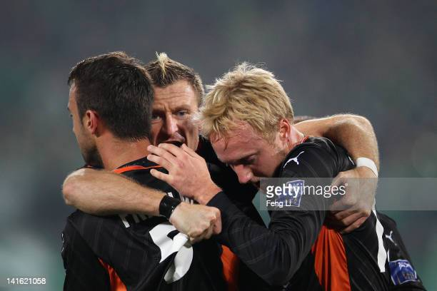 Mitch Nichols Besart Berisha and Ivan Franjic of the Roar celebrate scoring their first goal during the AFC Champions League Group F match between...