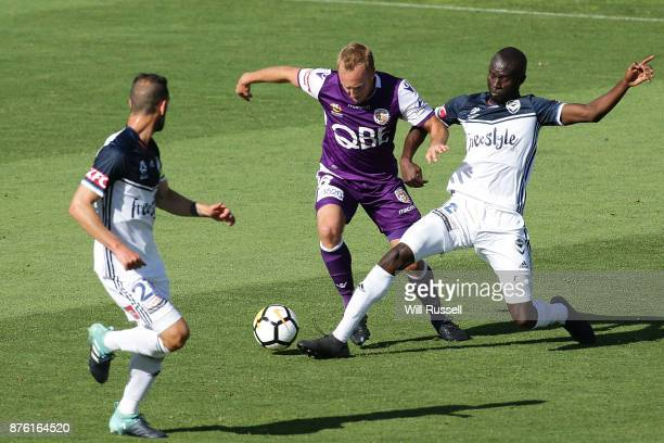 Mitch Nichols of the Glory is tackled by Stefan Nigro of the Victory during the round seven ALeague match between Perth Glory and Melbourne Victory...