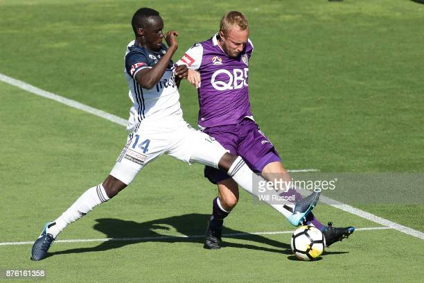 Mitch Nichols of the Glory is tackled by Thomas Deng of the Victory during the round seven ALeague match between Perth Glory and Melbourne Victory at...