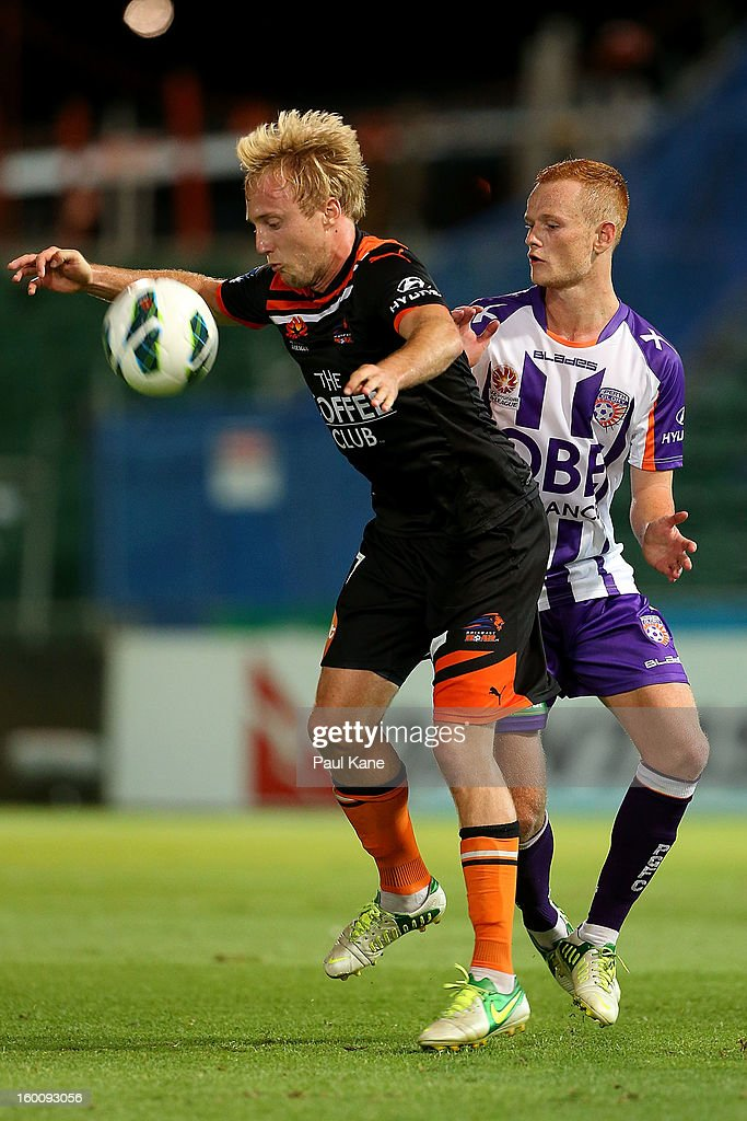 Mitch Nichols of the Roar and Jack Clisby of the Glory contest for the ball during the round 18 A-League match between the Perth Glory and the Brisbane Roar at nib Stadium on January 26, 2013 in Perth, Australia.