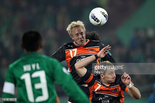 Mitch Nichols of the Roar heads their first goal during the AFC Champions League Group F match between China's Beijing Guoan and Australia's Brisbane...