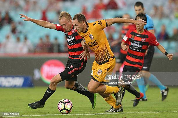Mitch Nichols of the Wanderers and Rostyn Griffiths of the Glory compete for the ball during the round 13 ALeague match between the Western Sydney...