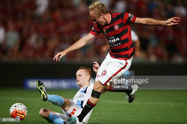 Mitch Nichols of the Wanderers beats Jack Clisby of Melbourne City to score the first goal during the round 17 ALeague match between the Western...