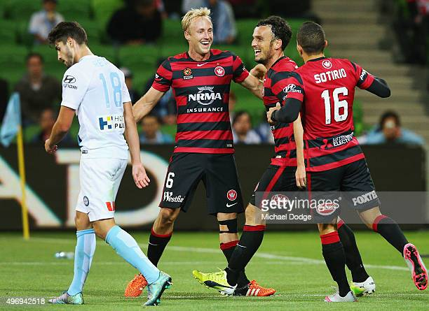 Mitch Nichols of the Wanderers celebrates a goal by Mark Bridge of the Wanderers during the round six ALeague match between Melbourne City FC and the...