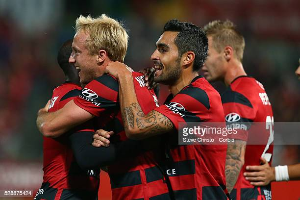 Mitch Nichols of the Wanderers celebrates his goal with teammates during the round one ALeague match between the Western Sydney Wanderers and the...
