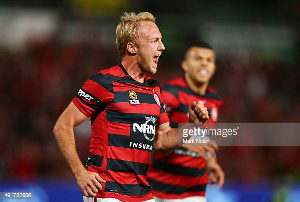 Mitch Nichols of the Wanderers celebrates scoring a goal during the round one ALeague match between the Western Sydney Wanderers and the Brisbane...