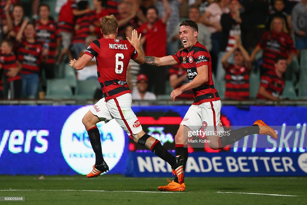 Mitch Nichols of the Wanderers celebrates with his team mate Scott Neville of the Wanderers after scoring a goal during the round nine A-League match between the Western Sydney Wanderers and the Brisbane Roar at Pirtek Stadium on December 5, 2015 in Sydney, Australia.