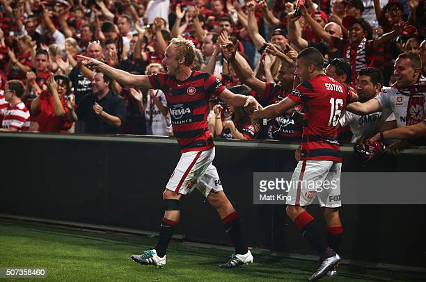 Mitch Nichols of the Wanderers celebrates with Jaushua Sotirio of the Wanderers and fans after scoring the first goal during the round 17 ALeague...
