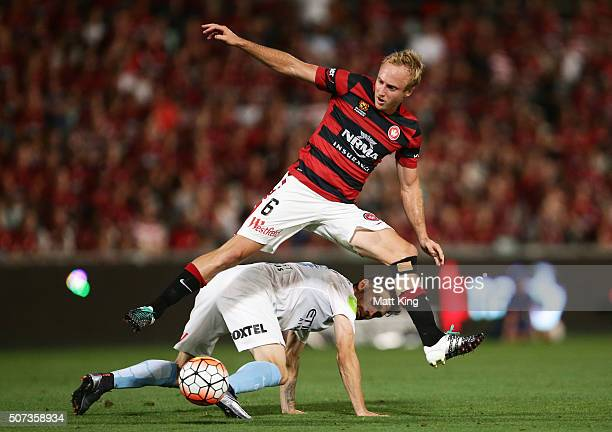Mitch Nichols of the Wanderers competes for the ball against Anthony Careers of Melbourne City during the round 17 ALeague match between the Western...