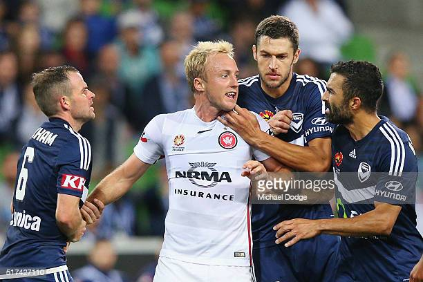 Mitch Nichols of the Wanderers is held back by Leigh Broxham of the Victory Matthieu Delpierre when arguing with Ben Khalfallah of the Victory during...