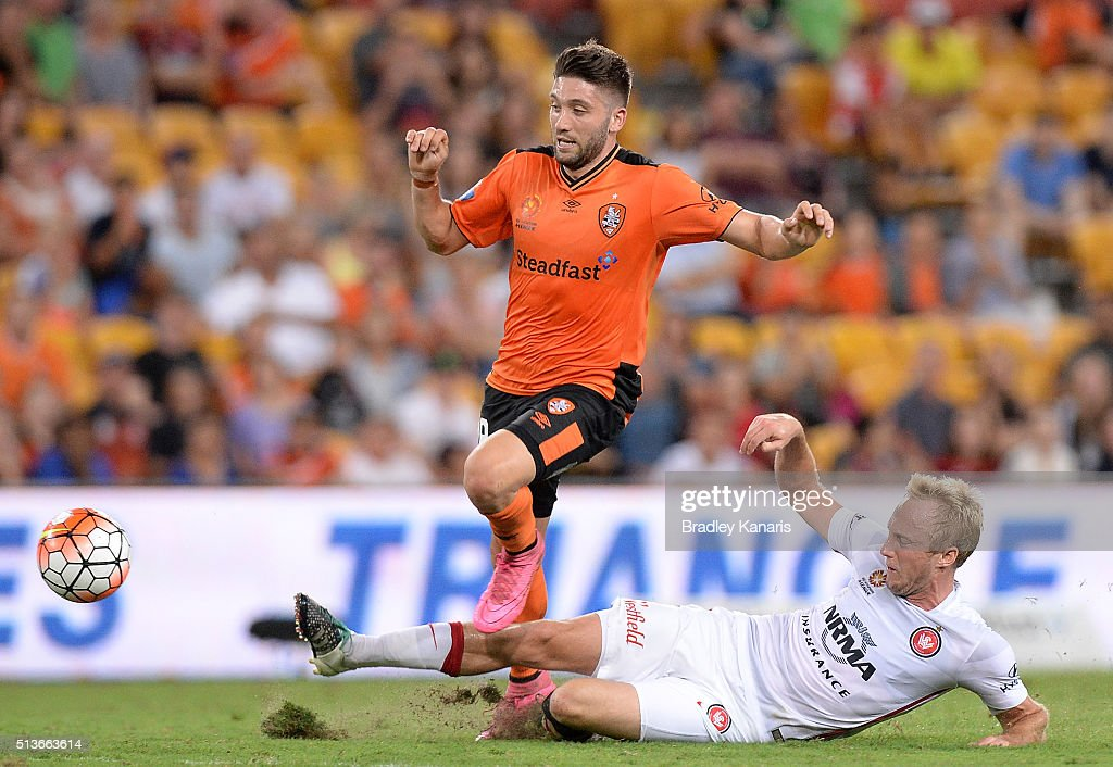 Mitch Nichols of the Wanderers is penalised for this tackle on Brandon Borrello of the Roar during the round 22 A-League match between the Brisbane Roar and the Western Sydney Wanderers at Suncorp Stadium on March 4, 2016 in Brisbane, Australia.