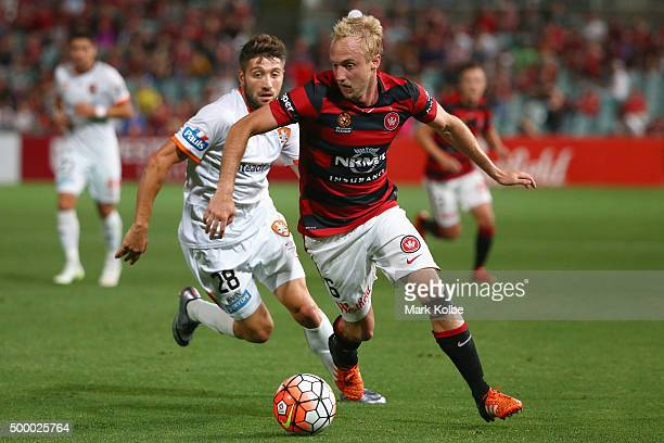 Mitch Nichols of the Wanderers runs the ball forward during the round nine ALeague match between the Western Sydney Wanderers and the Brisbane Roar...