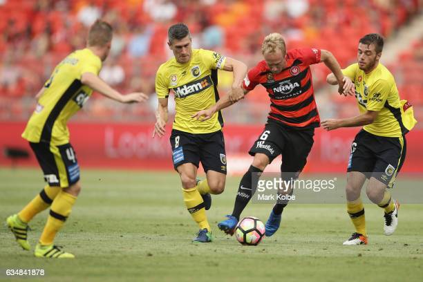 Mitch Nichols of the Wanderers takes on the Mariners defence during the round 19 ALeague match between the Western Sydney Wanderers and the Central...