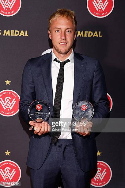 Mitch Nichols of the Western Sydney Wanderers Football Club poses with his Member's Player of the Year Award and his Rod Allen Award during the 2016...