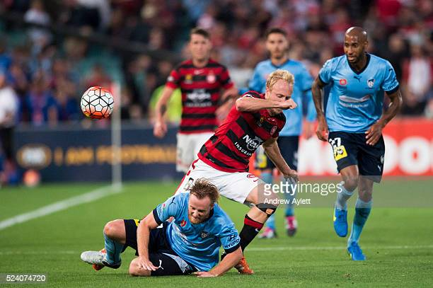Mitch Nichols of Western Sydney Wanderers is tackled by Rhyan Grant of the Sydney FC during the round 15 ALeague match between Sydney FC and the...