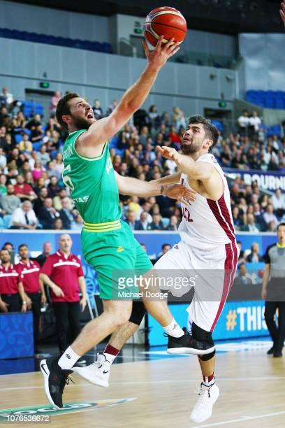Mitch Norton of the Boomers drives hard against Nasser Khalifa Al-Rayes of Qatar during Australia v Qatar the FIBA World Cup Qualifier on December...