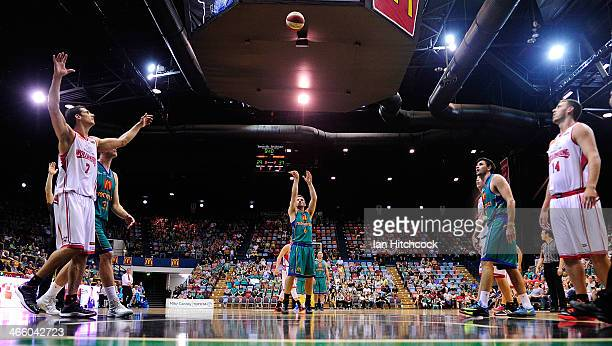 Mitch Norton of the Crocodiles attempts a free throw shot during the round 16 NBL match between the Townsville Crocodiles and the Wollongong Hawks at...