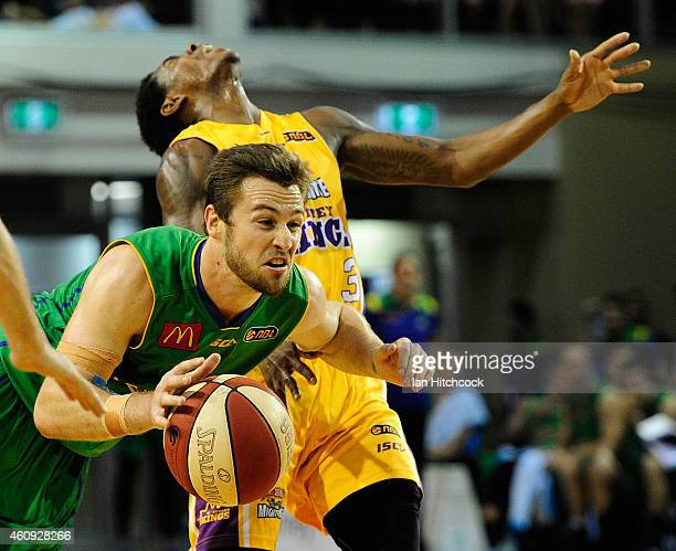 Mitch Norton of the Crocodiles attempts to get past past Kendrick Perry of the Kings during the round 13 NBL match between the Townsville Crocodiles...