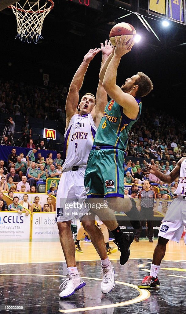 Mitch Norton of the Crocodiles attempts to make a shot over Graeme Dann of the Kings during the round 17 NBL match between the Townsville Crodcodiles and the Sydney Kings at Townsville Entertainment Centre on February 2, 2013 in Townsville, Australia.