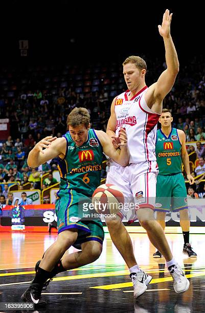 Mitch Norton of the Crocodiles collides with Tim Coenraad of the Hawks during the round 22 NBL match between the Townsville Crocodiles and the...