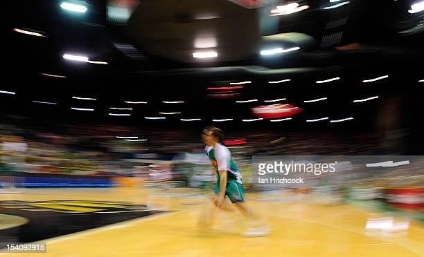 Mitch Norton of the Crocodiles drives to the basket during the warm up before the start of the round two NBL match between the Townsville Crocodiles...
