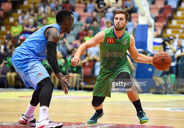 Mitch Norton of the Crocodiles looks to pass the ball past Cedric Jackson of the Breakers during the round nine NBL match between the Townsville...