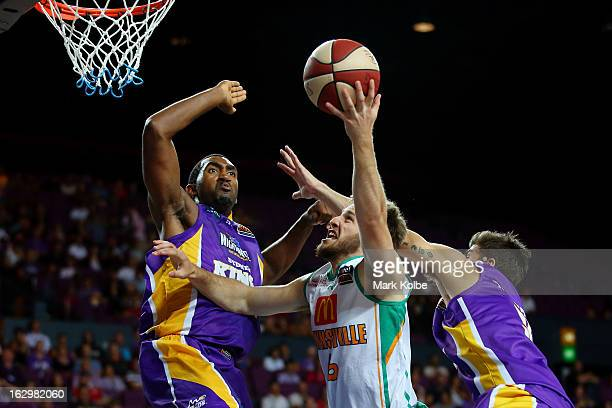 Mitch Norton of the Crocs shoots under pressure from Darnell Lazare of the Kings during the round 21 NBL match between the Sydney Kings and the...
