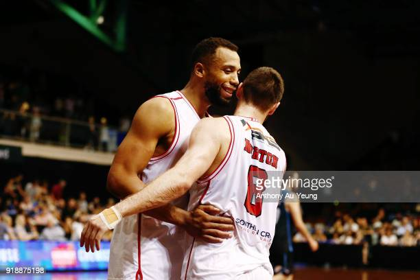 Mitch Norton of the Hawks celebrates with teammate Demitrius Conger after winning the round 19 NBL match between the New Zealand Breakers and the...