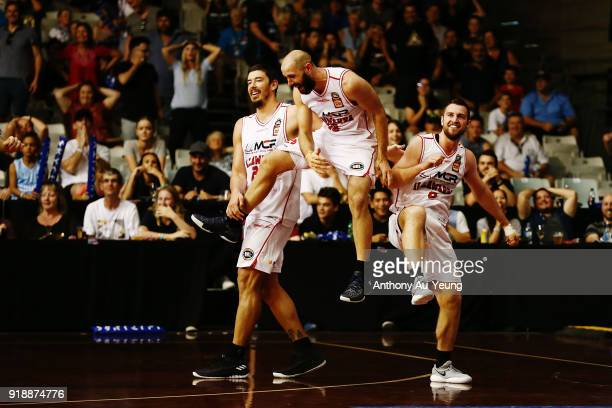 Mitch Norton of the Hawks celebrates with teammates after hitting the game winning three pointer during the round 19 NBL match between the New...