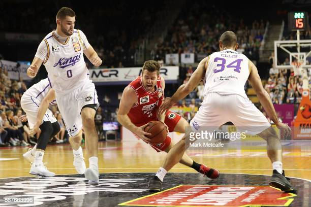 Mitch Norton of the Hawks trips over Perry Ellis of the Kings during the round four NBL match between the Illawarra Hawks and the Sydney Kings at...