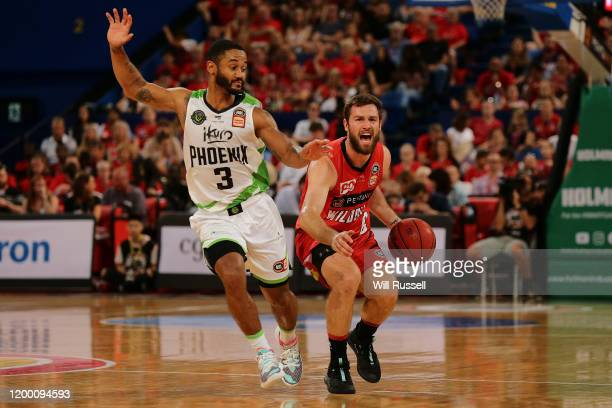 Mitch Norton of the Wildcats looks to pass the ball during the round 16 NBL match between the Perth Wildcats and the South East Melbourne Phoenix at...