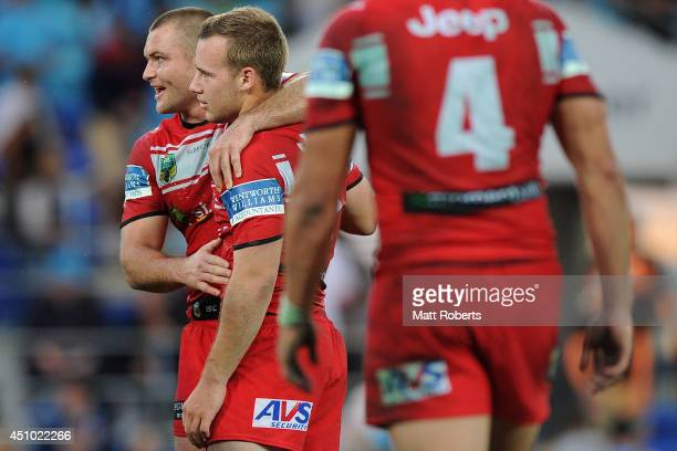 Mitch Rein and Adam Quinlan of the Dragons celebrate victory after the round 15 NRL match between the Gold Coast Titans and the St George Illawarra...