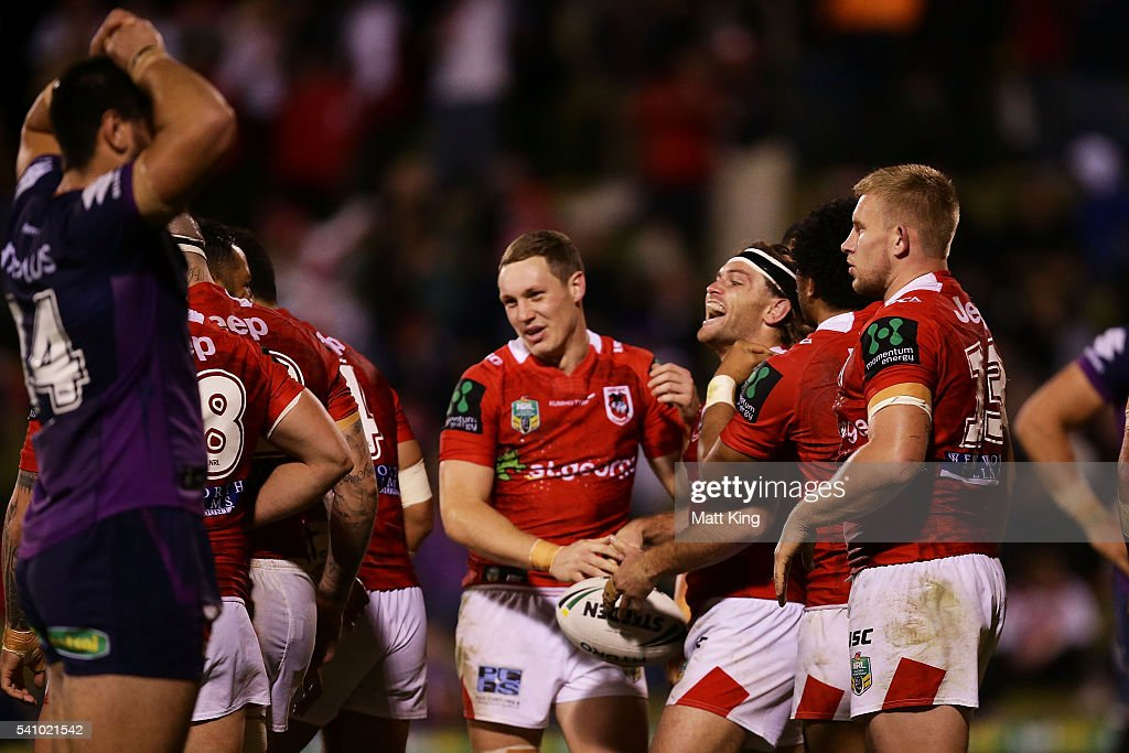 Mitch Rein of the Dragons celebrates with team mates after scoring a try during the round 15 NRL match between the St George Illawarra Dragons and the Melbourne Storm at WIN Stadium on June 18, 2016 in Wollongong, Australia.