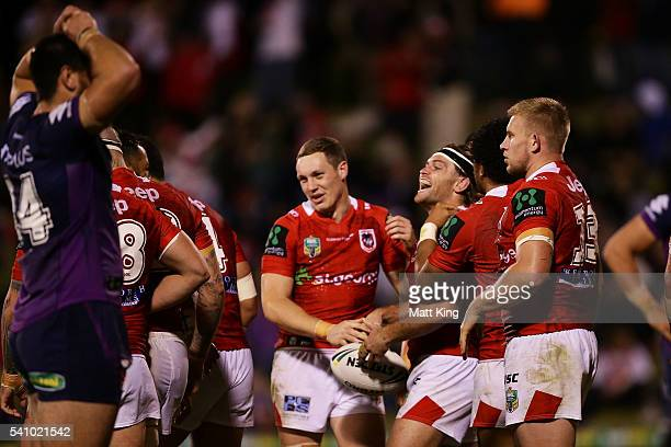 Mitch Rein of the Dragons celebrates with team mates after scoring a try during the round 15 NRL match between the St George Illawarra Dragons and...