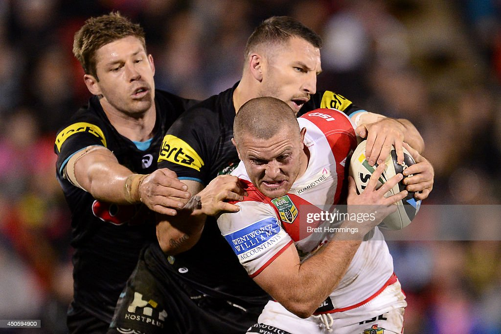 Mitch Rein of the Dragons is tackled during the round 14 NRL match between the Penrith Panthers and the St George Illawarra Dragons at Sportingbet Stadium on June 14, 2014 in Sydney, Australia.