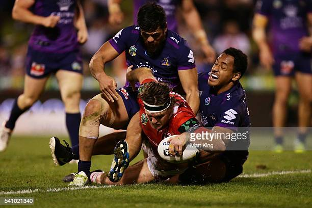 Mitch Rein of the Dragons scores a try during the round 15 NRL match between the St George Illawarra Dragons and the Melbourne Storm at WIN Stadium...